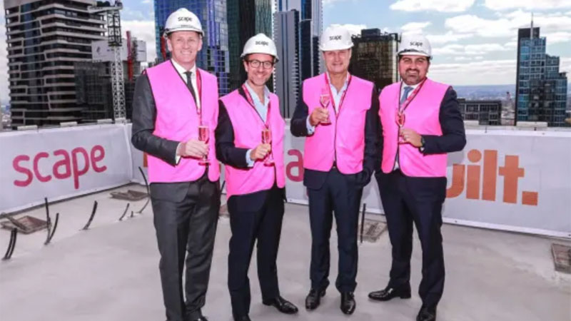 ▲ Scape's chief executive Stephen Gaitanos (far right) and chairman Craig Carracher (left) at the 43-storey Swanston Street project. Image: Wayne Taylor.