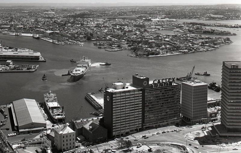 An old photograph shows No. 7 wharf on Sydney Harbour,  ADG House beside the former Caltex House and the IBM Centre. Source: CoS Archivepix