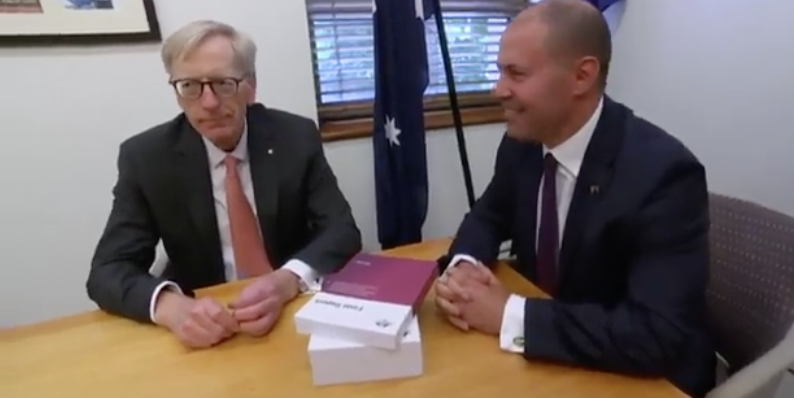 Commissioner Kenneth Hayne giving Treasurer Josh Frydenberg the final report from the Banking Royal Commission on Friday.