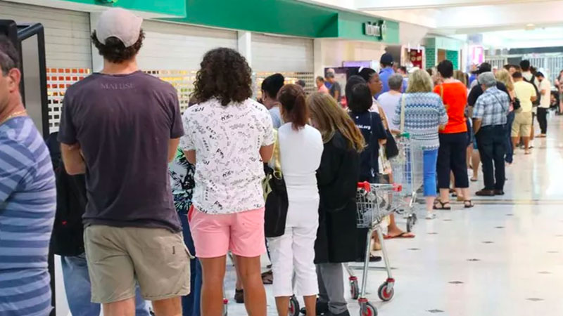 """Image of customers queuing outside Woolworths - illustrating the stockpiling that led to the federal government's Wednesday announcement strongly discouraging """"the panic purchase of food and other supplies""""."""