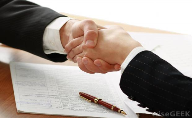 150323-handshake-two-people-in-suits-over-contract_620x380