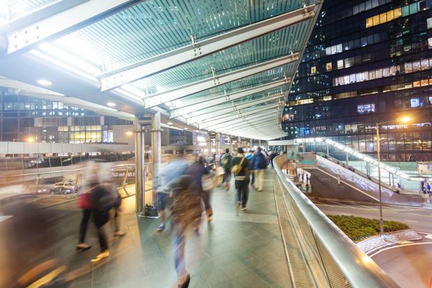 150520-photodune-10363406-commuters-walking-along-an-elevated-walkway-m