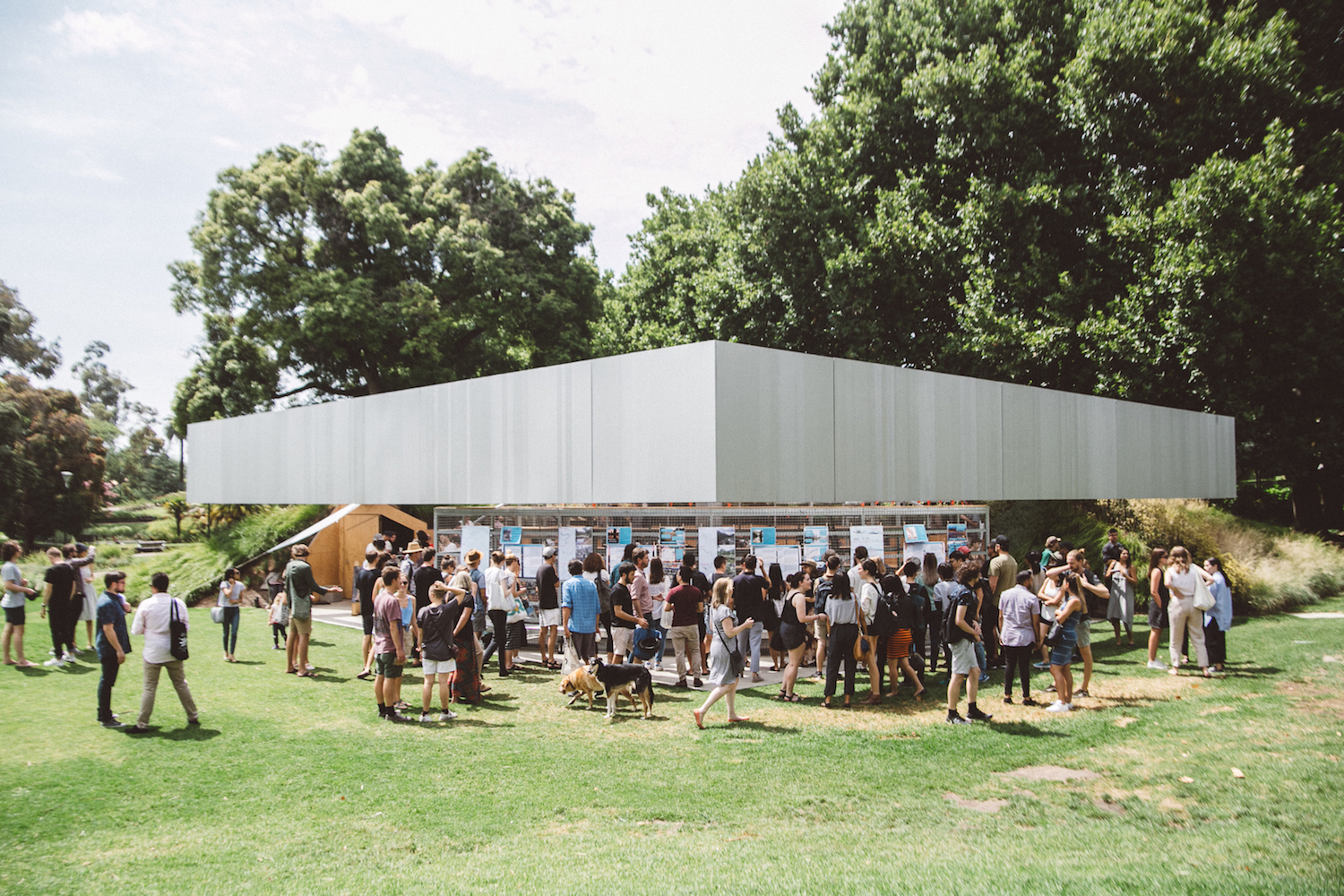 The 2017 MPavilion is a single storey, sheltered amphitheatre, with a focus on participatory design. The 19x19-metre aluminium clad structure allows for multiple configurations that can generate unexpected programming, echoing the ideals of the typology of the traditional amphitheatre.