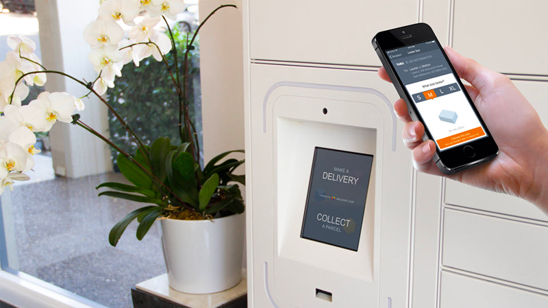 iPhone user unlocking Groundfloor locker with app.
