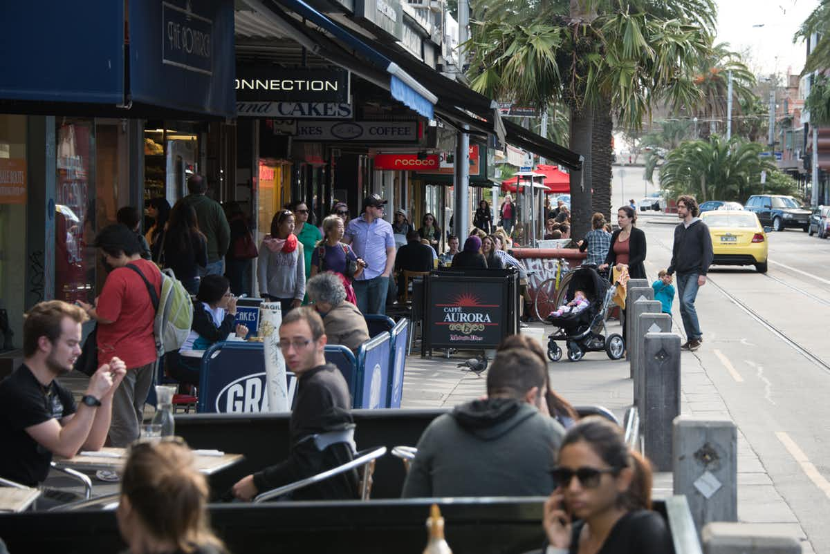 Cafes and bars provide a 'third place' where people can meet informally or be 'together alone', as seen here in St Kilda, Melbourne