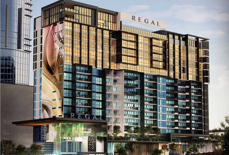 ▲ The Regal Residences is a 18 storey building with a rooftop pool featuring a golden glass facade on the upper levels and blue glass on the lower levels on a future Azzura development site at Imperial Square Southport.