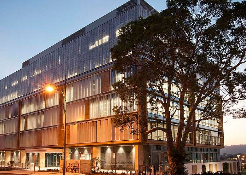 A six-storey office building at 32 Mann Street, Gosford has a sandstone, glazing and panelling facade.
