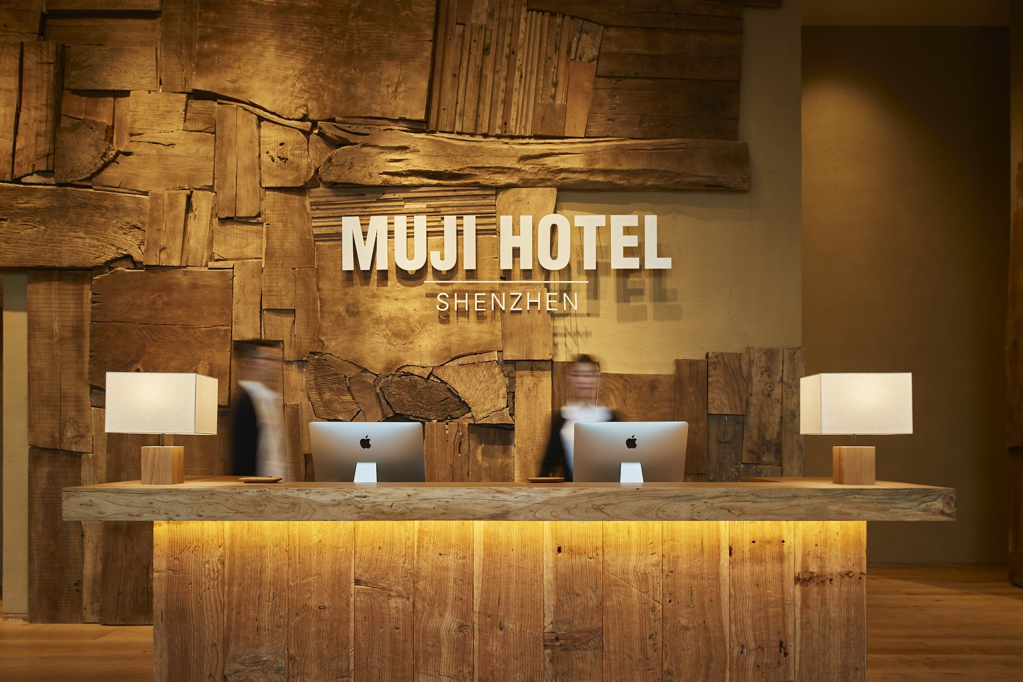 The interior design and amenities of the hotel have been executed by Muji, exemplifying its signature muted palette and attention to detail in spatial and product design.