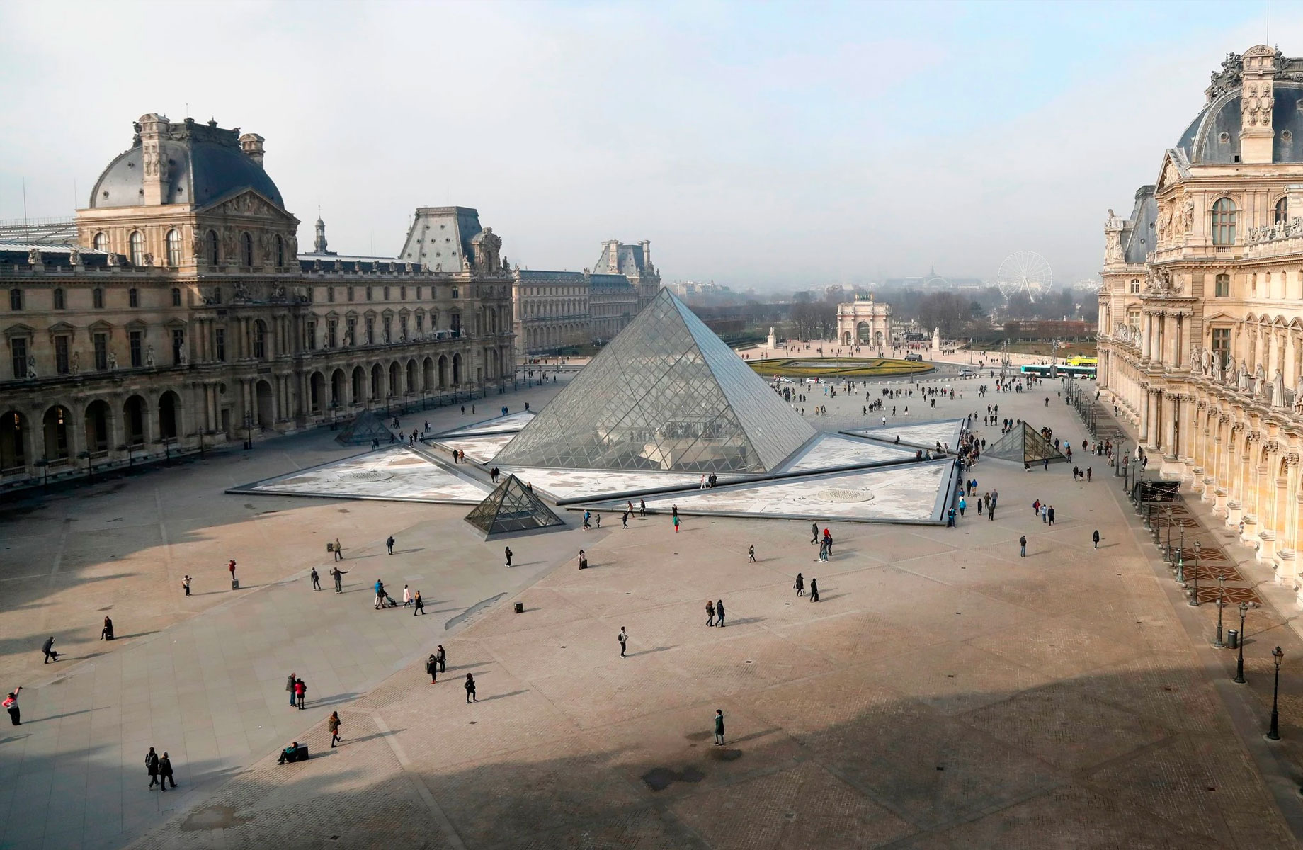 ▲ The glass pyramid that serves as an entry for the Louvre remains one of Pei's most famous commissions.