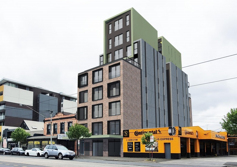 A nine storey residential building proposed in Richmond, Melbourne between a two storey traditional building a tyre shop.