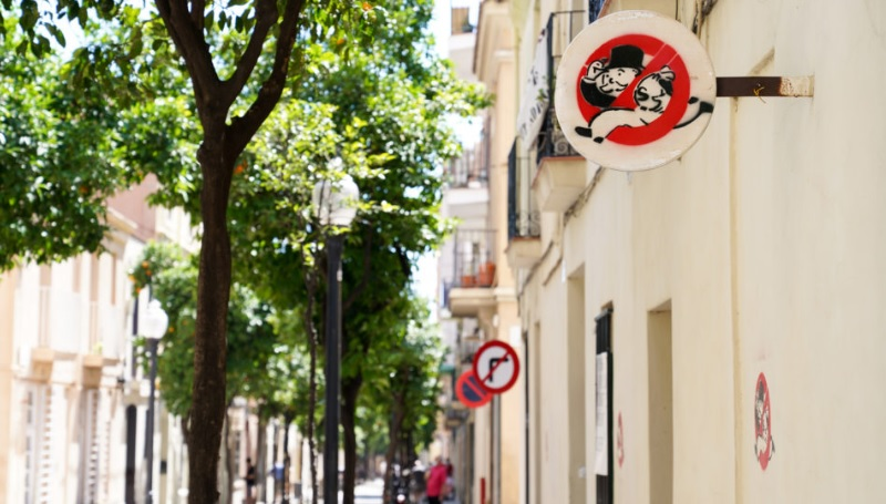 """Barcelona residents say no to """"Monopoly man"""" and big companies owning properties."""