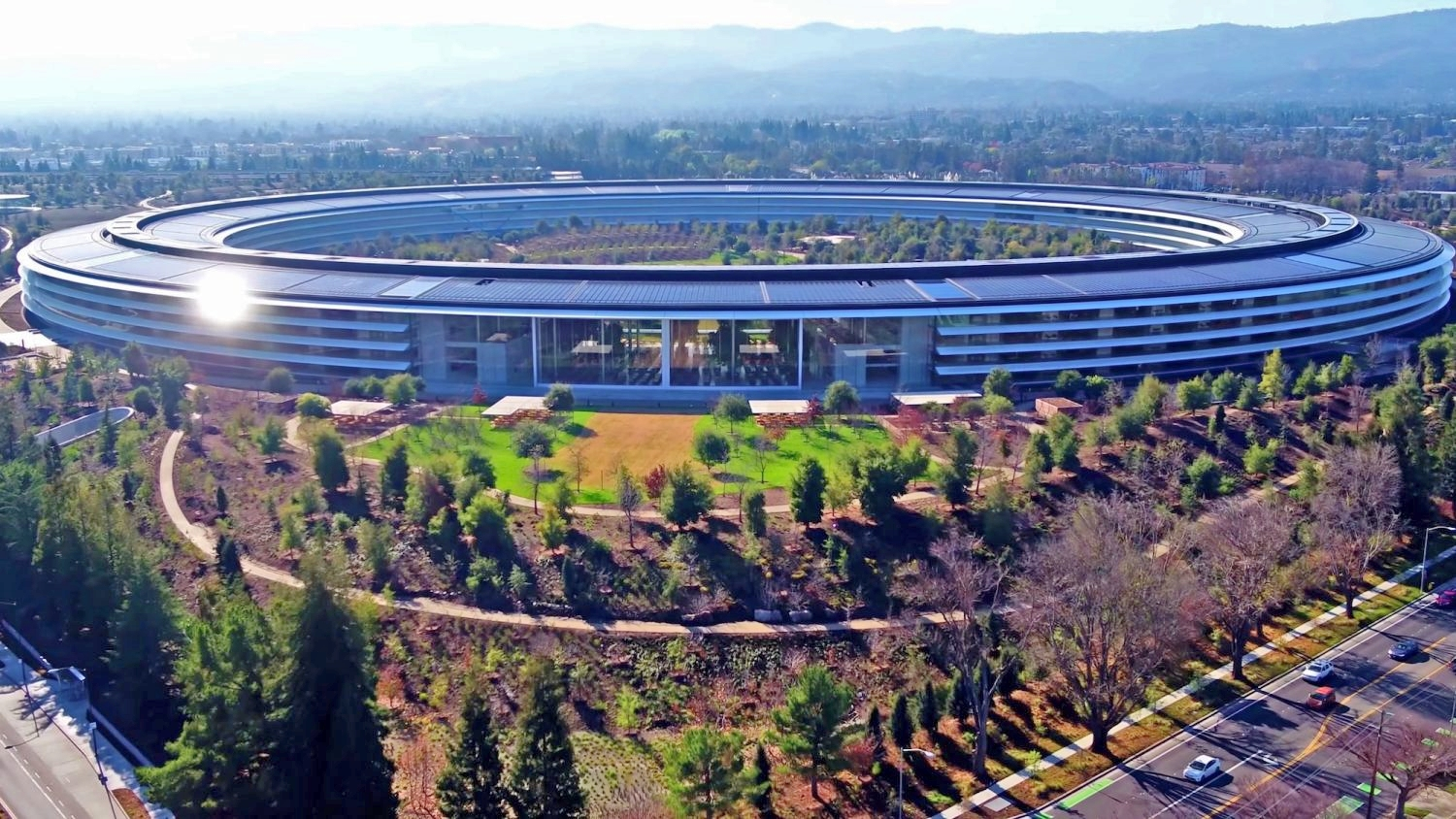 Apple Park in Cupertino, designed by Norman Foster, the vision of co-founder Steve Jobs.  Apple became the world's first trillion-dollar public company this month.