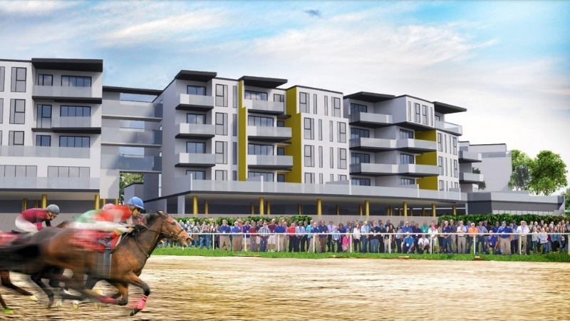 People stand outside proposed apartments alongside a horse racing track on the Gold Coast.