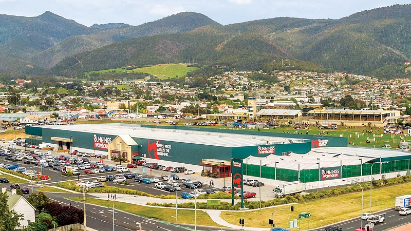 ▲ Bunnings sits next to The Royal Hobart Show venue in a grassy flat surrounded by houses and hills.