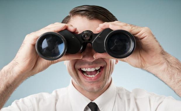 businessman-holding-binoculars2_620x380