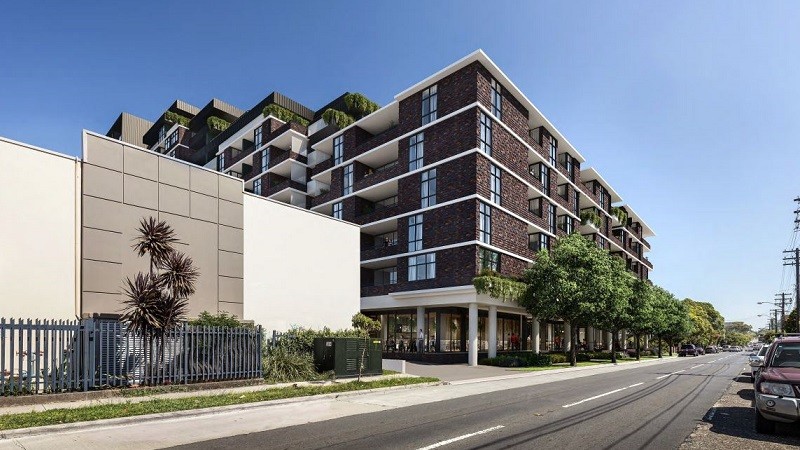 ▲ The Wicks Place building has dark brick and light concrete finishes with commercial space on the ground level.