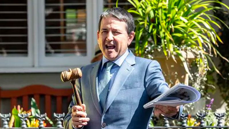 Image of auctioneer with gavel to illustrate the threat posed to auction clearance rates and the Australian housing market in general due to the federal government's social distancing measures.