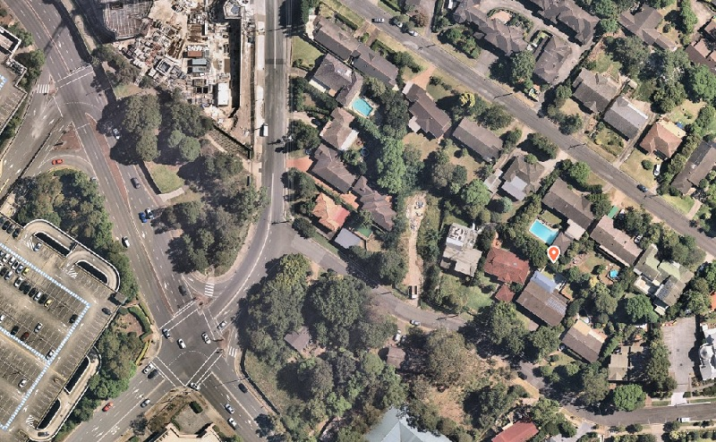 The aerial image shows the corner of Castle Towers Shopping Centre and Toplace's residential development nearby the Castle Hill suburban site.