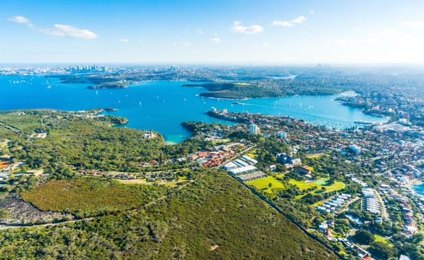 Aerial view Sydney Bay. View on Sydney harbourside suburbs from above. Aerial view on Sydney harbourside, Sydney CBD, Manly, Parramatta and Sydney Harbour National Park